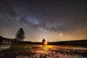 A man looking at the night sky.