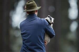 A man with a rescued animal.